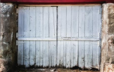 hinged: Worn White Barn Door Backdrop Stock Photo