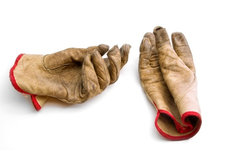 work glove: Worn and Weathered Gloves on White Backdrop