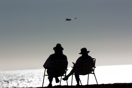 Senior Couple Relaxing at Point Dume State Beach in Malibu, California