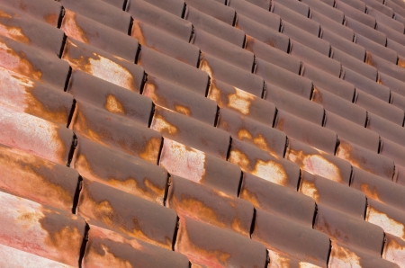 Worn and Rusty Roof Tiles in Diagonal Pattern photo