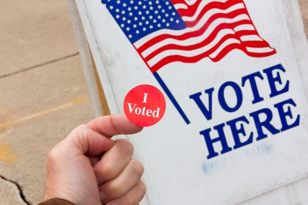 voted: Voter Proudly Displays Evidence that He Voted on Election Day in the United States  Stock Photo