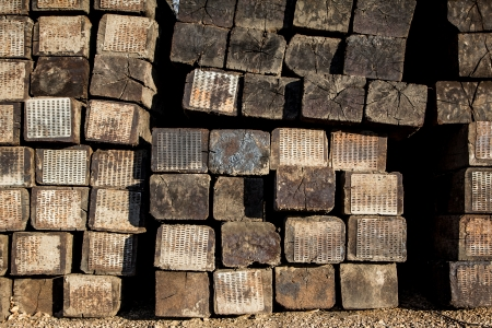 creosote: Stacked Railroad Ties Near the Side of the Tracks