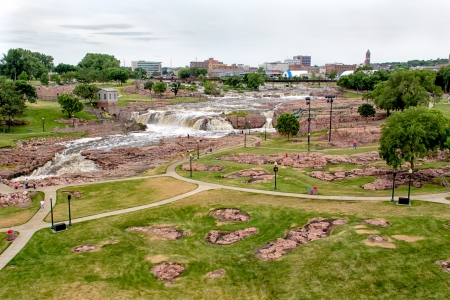 sioux: Raging Water of the Big Sioux River at Falls Park and Sioux Falls Skyline