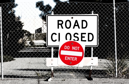 way out: Road Closed Sign Before Chain Link Fence