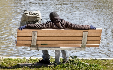 A Man and all His Wordly Possessions Asleep on a Park Bench photo