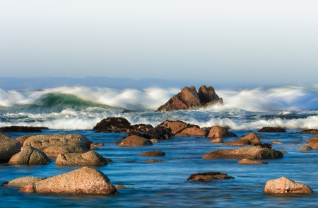 The Oceans Fury as Waves Crash Over Rocks at Monterey Bay in Pacific Grove California.