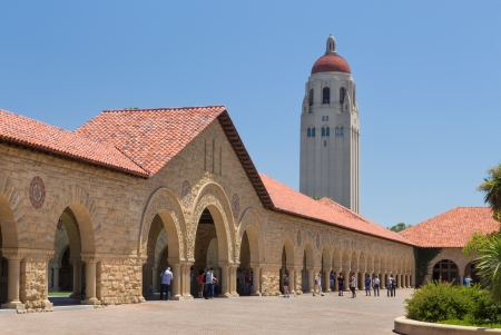 hallowed: STANFORD, UNITED STATES - July 6: Historic Stanford University features original sandstone walls with thick Romanesque features before a quadrant of open courtyards. July 6, 2013.