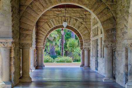 STANFORD, UNITED STATES - July 6: Original walls at Stanford University.  The historic university features original sandstone walls with thick Romanesque features.  July 6, 2013.