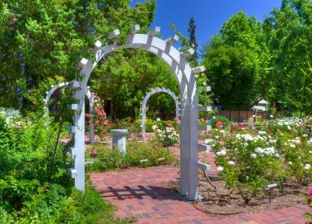 english rose: Entrance to an English Rose Garden Stock Photo