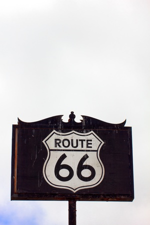 Weathered and Worn Route 66 Road Sign in Vertical Stock Photo - 21530674