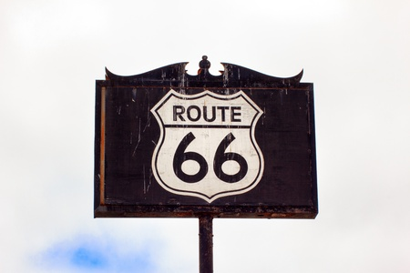 Weathered and Worn Route 66 Road Sign Stock Photo - 21530675