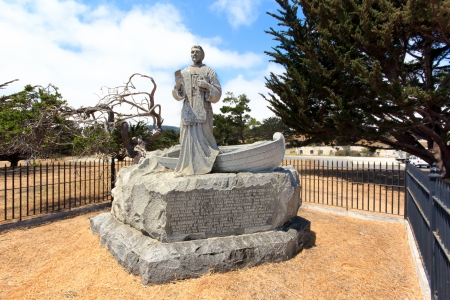 colonization: MONTEREY, CAUSA - July 30: Mmonument of Spanish friar Junipero Serra overlooks Monterey Bay at the Presidio of Monterey. The monument is at the location where Serra landed in 1770 and founded the Mission San Carlos, Monterey. July 30, 2013