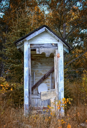 dilapidated: Dilapidated Outhouse in the Rural Wisconsin Countryside