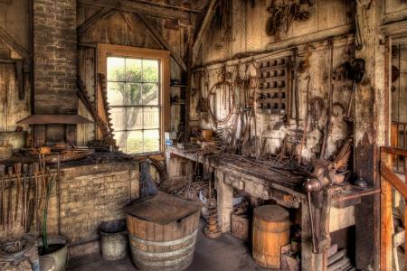 vise: Old Blacksmith Shop en el oeste americano Foto de archivo