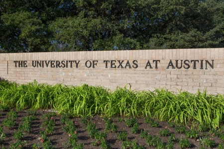 AUSTIN,TXUSA - NOVEMBER 14: Entrance Sign to the  campus of the University of Texas, a state research university and the flagship institution of the The University of Texas System. November 14, 2013.