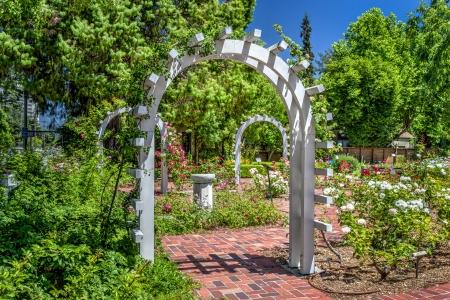 entrance arbor: Entrance to an English Rose Garden Stock Photo