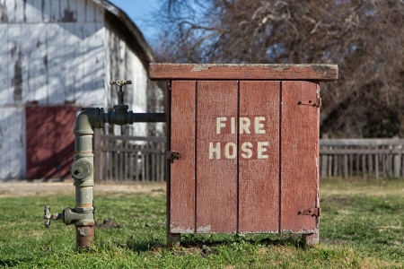 Old Fashioned Fire Hose Box on Rural Farm in the United States photo