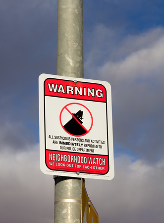 SALINAS, CAUSA - JANUARY 30, 2014: Neighborhood Watch warning sign featuring likeness of Boris the Burglar in an American city.
