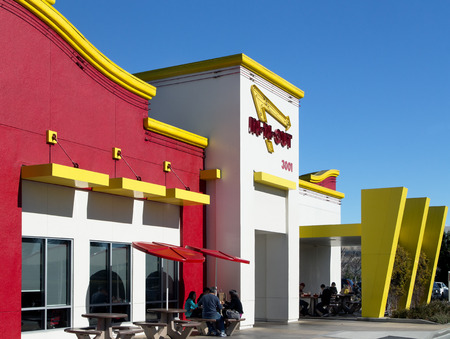 SUNNYVALE, CA - FEBRUARY 1, 2014: Exterior of an In-N-Out Burger restauruant. In-N-Out Burgers, Inc. is a regional chain of fast food restaurants with locations the United States Southwest.