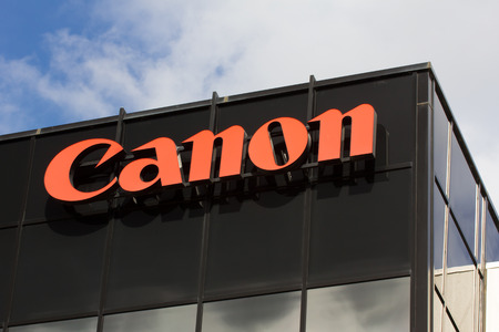 SAN JOSE, CAUSA - MARCH 1, 2014:  Canon Corporate Headquarters Sign. Canon is a Japanese multinational corporation specialized in the manufacture of imaging and optical products.