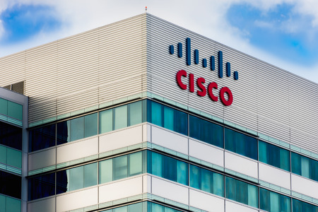 headquartered: SANTA CLARA, CAUSA - MARCH 1, 2014:  Cisco Facility in Silicon Valley. Cisco Systems, Inc. is an American corporation headquartered in San Jose, California that manufactures and sells computer networking equipment. Editorial