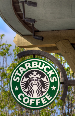 SALINAS, CA/USA - APRIL 3, 2014: Starbucks sign in at Starbucks Coffee shop sign. Starbucks is an American global coffee company and coffeehouse chain based in Seattle, Washington.