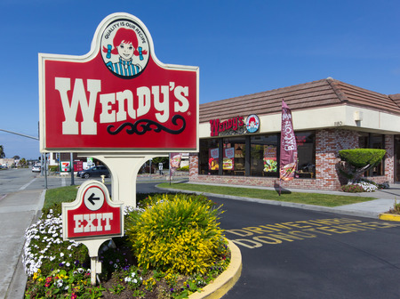 food chain: SEASIDE, CAUSA - MARCH 27, 2014:  Wendys fast food restaurant exterior and sign. Wendys is the worlds third largest hamburger fast food chain with approximately 6,650 locations.