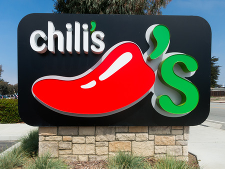 chili's restaurant: MONTEREY, CAUSA - APRIL 14, 2014: Chilis Restaurant Sign. Chilis Grill & Bar is an casual dining restaurant chain with locations in the United States, Canada, and 31 countries worldwide. Editorial