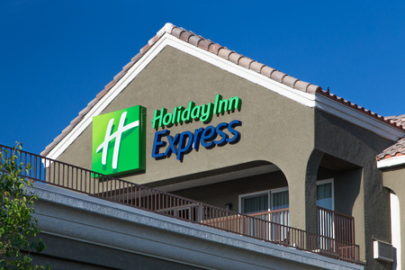 branded: LANCASTER, CAUSA - APRIL 20 2014: Holiday Inn Express Sign motel exterior. Holiday Inn Express is a mid-priced hotel chain branded by InterContinental Hotels Group.