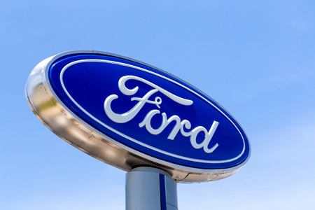SAN JOSE, CAUSA - MAY 24, 2014: Ford automobile dealership sign. Ford Motor Company is an American multinational automaker headquartered in Dearborn, Michigan. Editorial