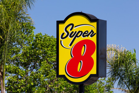 establishment states: GILROY, CAUSA - MAY 26, 2014: Super 8 Motel Sign.  Super 8 Motels is the worlds largest budget hotel chain, with motels in the United States and Canada, as well as newer properties in China.