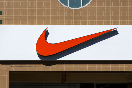 athletic wear: GILROY, CAUSA - MAY 26, 2014: Nike store exterior. Nike markets and sells footwear, apparel, equipment, accessories and services. Editorial