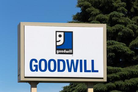 nonprofit: BLOOMINGTON, MNUSA - JUNE 21, 2014:  Goodwill store exterior sign. Goodwill Industries is a nonprofit organization that provides job training programs for people with disabilities.