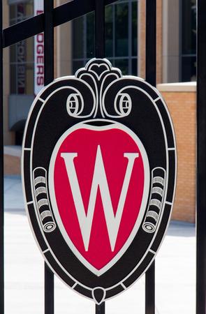 university of wisconsin: MADISON, WIUSA - JUNE 26, 2014: University of Wisconsin logo at Camp Randall. The University of Wisconsin is a Big Ten University in the United States.