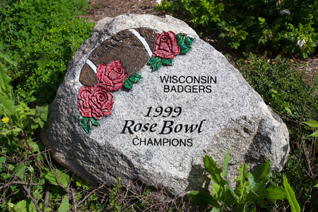 university of wisconsin: MADISON, WIUSA - JUNE 26, 2014:  Painted rock at Camp Randall noting Wisconsin Badgers 1999 Rose Bowl Victory.