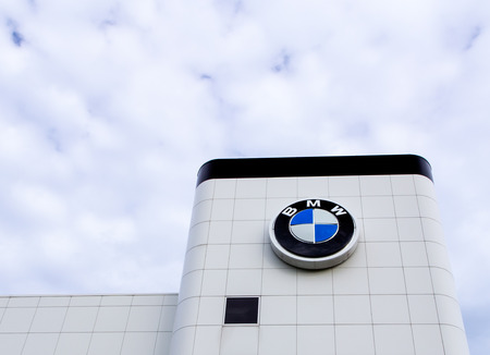 BLOOMINGTON, MNUSA - JUNE 22, 2014: BMW automobile dealership exterior. Bavarian Motor Works is a German automobile, motorcycle and engine manufacturing company founded in 1916.