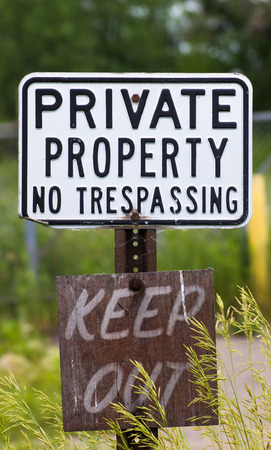 tresspass: Weathered no trespassing sign in vertical. Stock Photo