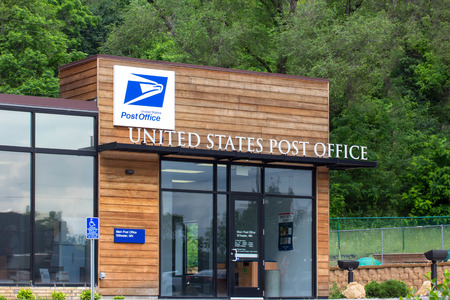 united states postal service: STILLWATER, MNUSA - JUNE 27, 2014: United States Post Office building. The United States Postal Service provides postal service in the United States.