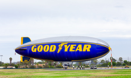 blimps: CARSON, CAUSA - AUGUST 2, 2014: The Goodyear blimp. The Goodyear blimp is any one of a fleet of blimps operated by Goodyear Tire and Rubber Company for advertising purposes.