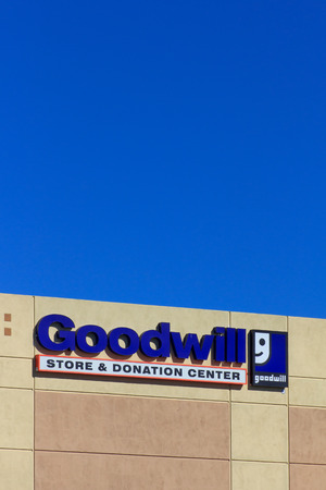 goodwill: VALENICA, CAUSA - AUGUST 5, 2014: Goodwill store exterior sign. Goodwill Industries is a nonprofit organization that provides job training programs for people with disabilities. Editorial