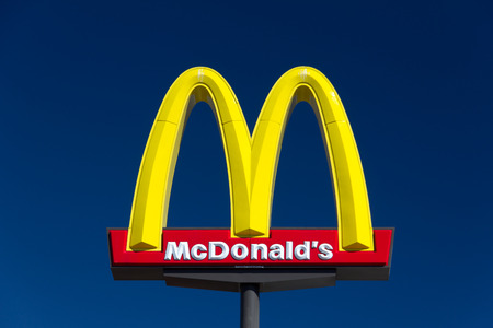 VALENICA, CA/USA - AUGUST 5, 2014: McDonald's restauraunt sign. The McDonald's Corporation is the world's largest chain of hamburger fast food restaurants.