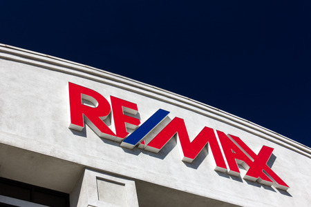 commision: SANTA CLARITA, CAUSA - AUGUST 16, 2014. REMAX building exterior and sign. REMAX International is an American international real estate company that relies on a franchise system.