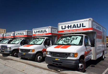 PASADENA, CAUSA - AUGUST 16, 2014. U-Haul trucks lined up in a row. U-Haul is a moving equipment and storage rental company based in Phoenix, Arizona.