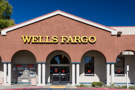 VALENCIA, CAUSA - AUGUST 17, 2014. Wells Fargo bank exterior. Wells Fargo & Company is an American multinational banking and financial services holding company headquartered in San Francisco, California. Editorial