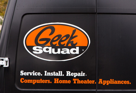 squad: SAN SIMEON, CAUSA - SEPTEMBER 21, 2014: Geek Squad logo on vehicle. The Geek Squad offers various computer-related services and accessories for residential and commercial clients.