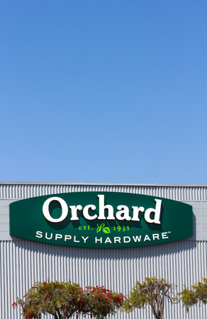 retailer: SAND CITY, CAUSA - March 27, 2014: Orchard Supply Hardware exterior. Orchard Supply Hardware (OSH) is an American retailer of home improvement and gardening products. Editorial
