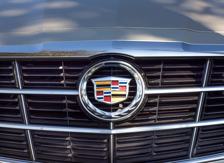 grille: PASADENA, CAUSA - OCTOBER 25, 2014: Cadillac grille and logo. Cadillac is a division General Motors Company that markets luxury vehicles worldwide.
