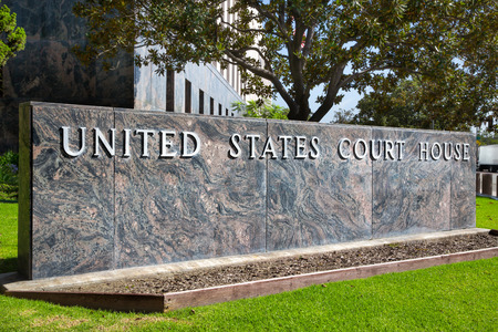 United States Court House sign on green lawn