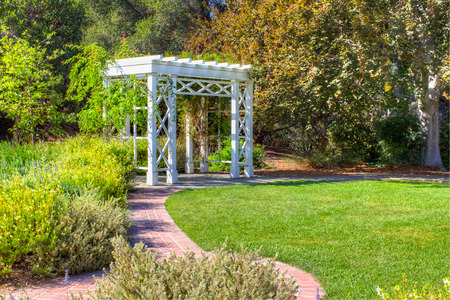 entrance arbor: Garden Trellis and Path with Green Lawn and Foliage