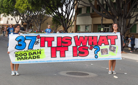 PASADENA, CAUSA - NOVEMBER 15, 2014: Unidentified participants and merry-goers at the 37th annual Pasadena Doo Dah Parade. The Doo Dah Parade is a satirical parody of the Tournament of Roses parade.